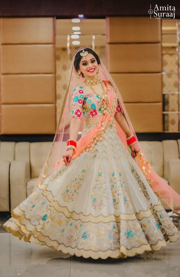 Photo of White and peach lehenga