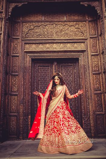 Photo of Bride with red and gold lehenga and open hair