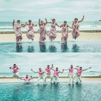 Matching bridesmaids and groomsmen jumping in water