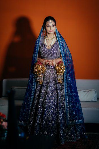 Photo of Offbeat bridal lehenga in navy blue