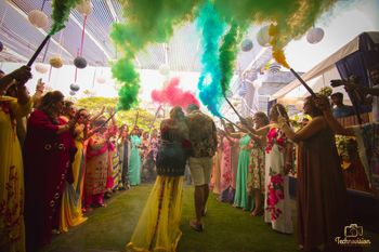 Mehendi entry idea with guests holding smoke sticks