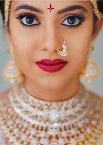 Dewy finish with matte red lisptick makeup for a south indian bride