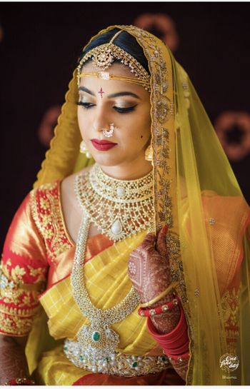 South Indian layered bridal jewellery with diamonds and emeralds