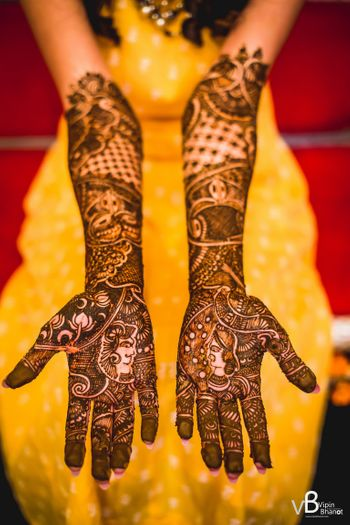 A girl with mehendi on her arms