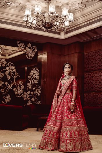 Red and gold Sabyasachi bridal lehenga with double dupatta