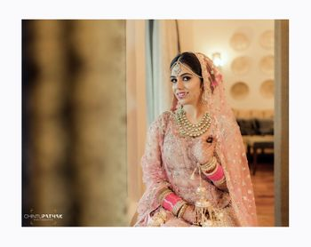 Photo of Pretty pink chooda with baby pink bridal lehenga