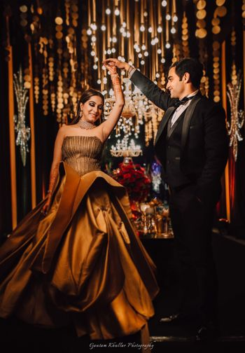 Gold ruffled cocktail gown for sangeet