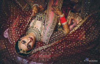 Unique bridal portrait with bride lying