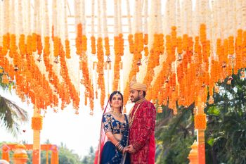 Bride and groom with contrasting decor in orange