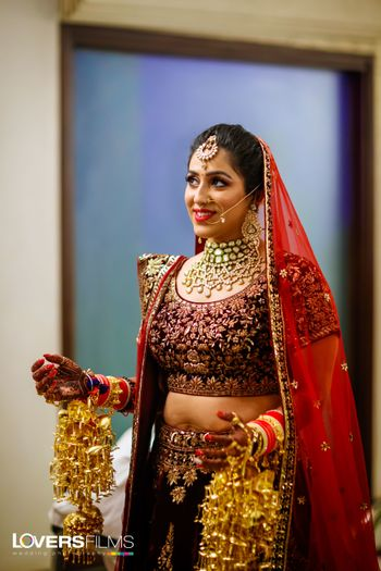 Maroon bridal lehenga with red dupatta