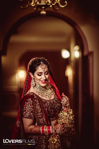 Happy bride in maroon embellished lehenga