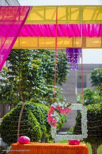 Pretty floral photo booth for mehendi