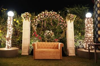 Stunning reception decor with floral and sofa seating