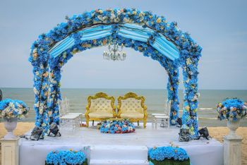 Photo of Blue theme mandap by the beach