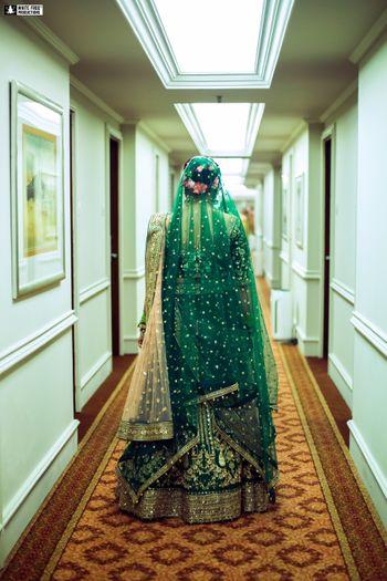 A bride in dark green