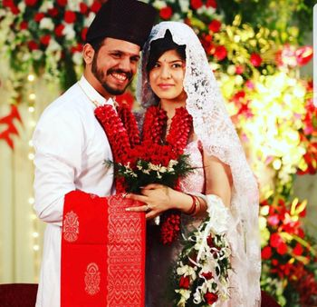 A parsi bride and groom in white and red