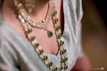 Layered diamond and emerald teardrop necklace