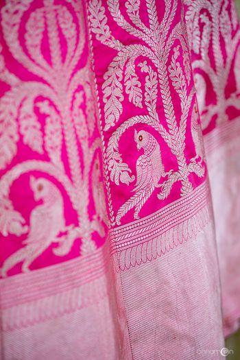 Bright pink benarasi lehenga with parrot motifs