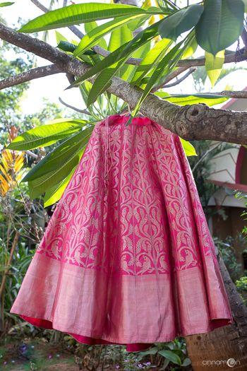 Photo of Bright pink benarasi lehenga with parrot motifs