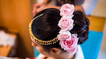 Stunning pink roses for bridal bun hairstyle