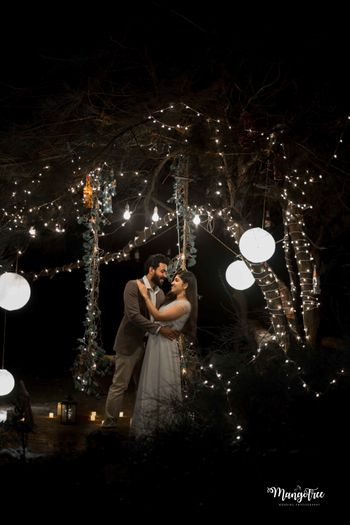 Cute couple photo for engagement with fairy lights