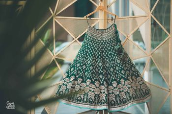 Dark green lehenga on hanger