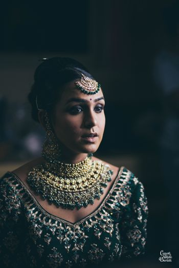 Heavy bridal jewellery with green beads