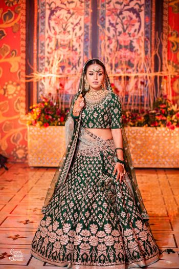 Offbeat dark green bridal lehenga with gota patti