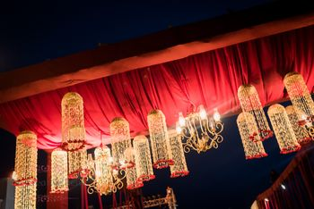 White and red hanging floral string in night decor