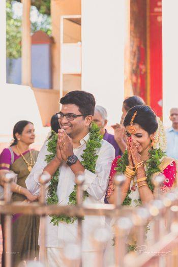 Photo of A south Indian couple praying on their wedding day