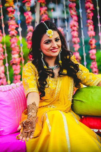 Photo of Bridal mehendi portrait in yellow lehenga