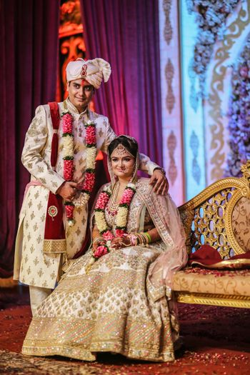 Sabyasachi bride in ivory with matching groom