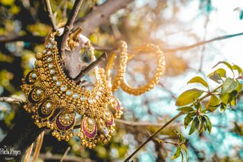 Bridal necklace and kada on branches
