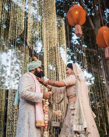Jaimala shot with matching bride and groom