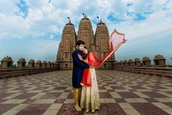A couple pose for htie rpre-wedding shoot at a temple complex