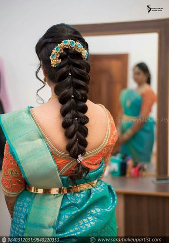 Fishtail braid hairstyle for South Indian bride