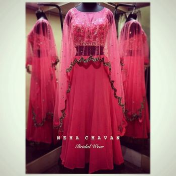 Light pink lehenga with long net cape with gold border
