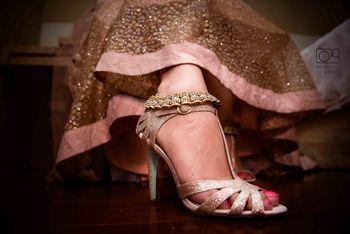 Silver Bridal Heels Under Pink Lehenga