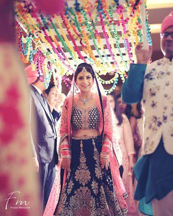 Bridal entry idea under colourful phoolon ka chadar