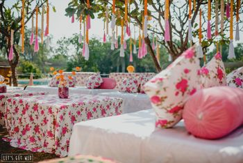 Pretty pink mehendi decor with hanging parandis