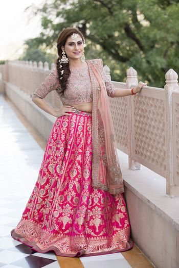 Photo of Bride in shades of pink benarasi lehenga