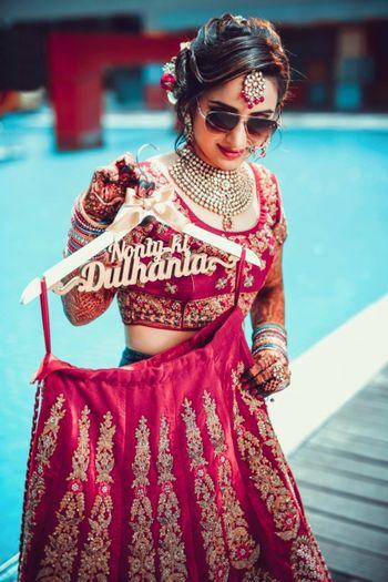 Bride with lehenga on customised bridal lehenga