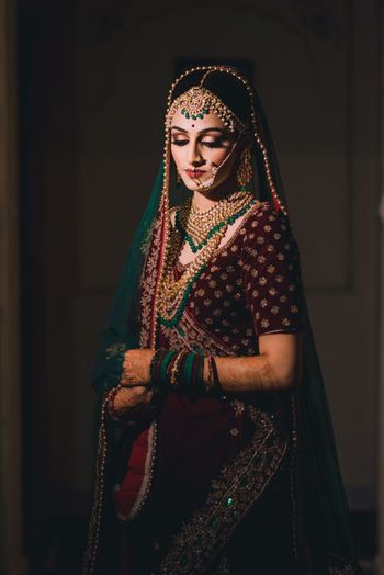 Bride with contrasting jewellery and deep lehenga