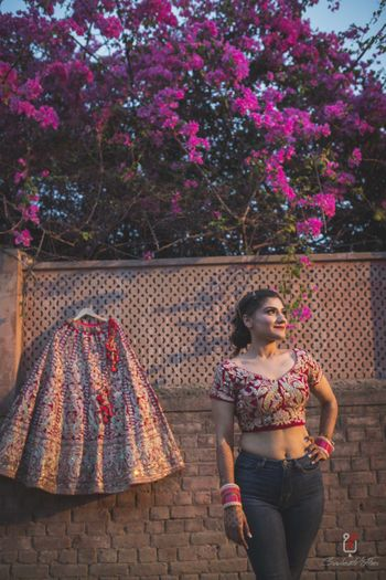 Bride in jeans with lehenga shot