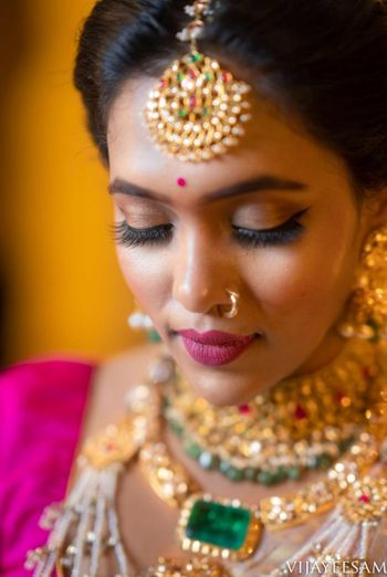 South indian bride with pink and brown makeup