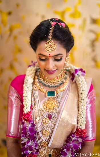 South indian bridal look with jaimala and maangtikka
