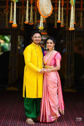 south indian bride and groom in contrasting outfits