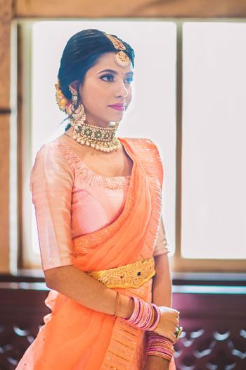south indian contrasting blouse design with orange saree