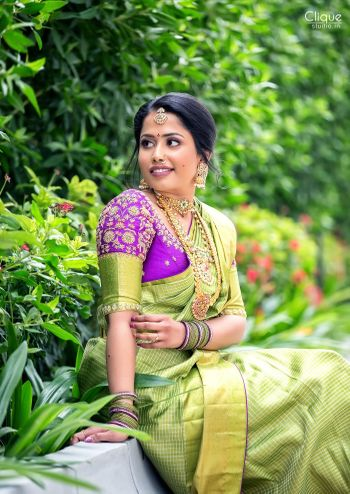 Photo of South Indian bride in a lime green saree with a  purple blouse.