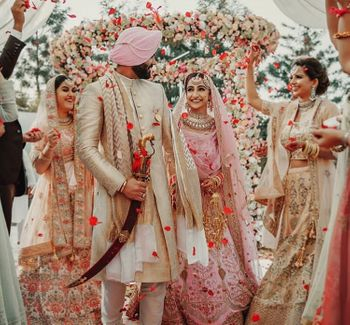 Photo of Pastel bride and groom during sikh wedding